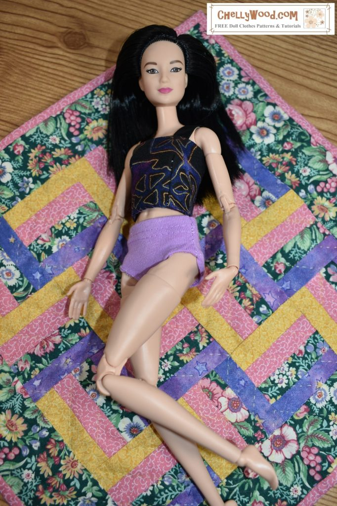 The image shows a Made-to-Move Barbie lying on a handmade miniature quilt. She wears handmade underpants with a tank top. (Knickers -- underwear.) Click on the link in the caption, and it will take you to a page where you can download and print all the free printable sewing patterns for making these doll clothes, along with links to tutorial videos that show you how to make these undergarments.