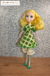 On this very simple set, an Ever After High doll models a short dress with an A-like skirt and cuffs beneath the dress's puff short sleeves. Under the dress, the doll wears a pair of bloomers with lace around the bottom of them. Click on the link in the caption, and it will take you to a page where you can download and print all the free printable sewing patterns for making these doll clothes, along with links to tutorial videos that show you how to make this outfit.