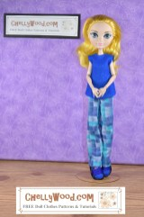 This Ever After High doll wears a simple felt shirt over a pair of straight-leg pants. The pants, with their mosaic print in checks of blue and turqoise remind us of a pair of lounge pants or even pajama pants. But they may be colorful day-wear as well. It's hard to tell. She wears a pair of matching handmade blue shoes also. Click on the link in the caption, and it will take you to a page where you can download and print all the free printable sewing patterns for making these doll clothes, along with links to tutorial videos that show you how to make this outfit.