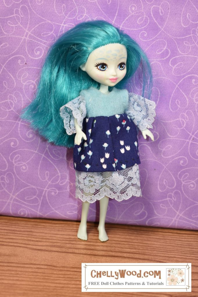 The image shows a Taylee Turtle doll from the Mattel Enchantimals collection of dolls / miniatures. The doll is wearing a handmade dress of felt, cotton, and lace trim. If you'd like to see the patterns and tutorial videos for making this outfit (or if you would like to download these patterns for free) please click on the link in the caption.