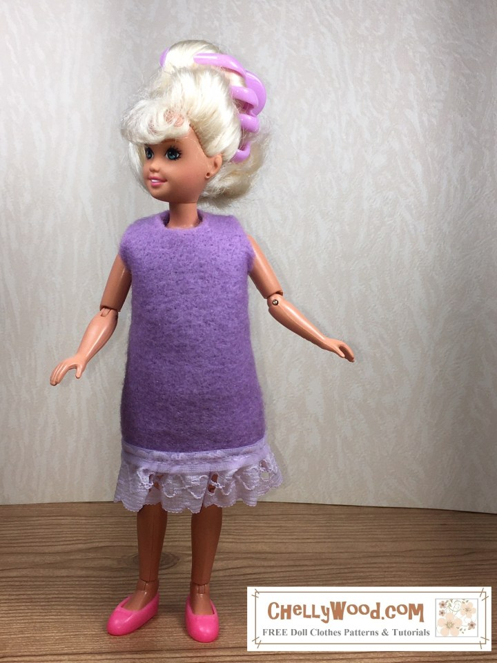 The image shows a vintage Stacie doll from the 1980's wearing a lavender-colored felt dress with an eyelet lace trim at the bottom. Click on the link in the caption, and it will take you to a page where you can download the free PDF sewing pattern for making this doll dress to fit Stacie dolls; the page also shows a video tutorial with instructions for making this dress, which is really easy to sew and ideal for beginners who are just learning how to sew.