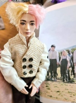 Here we see a BTS doll with handmade doll clothes made by Cindy C using free printable doll clothes patterns by ChellyWood.com including a vest, high-collar shirt with cuffs, and a pair of elastic waist pants.