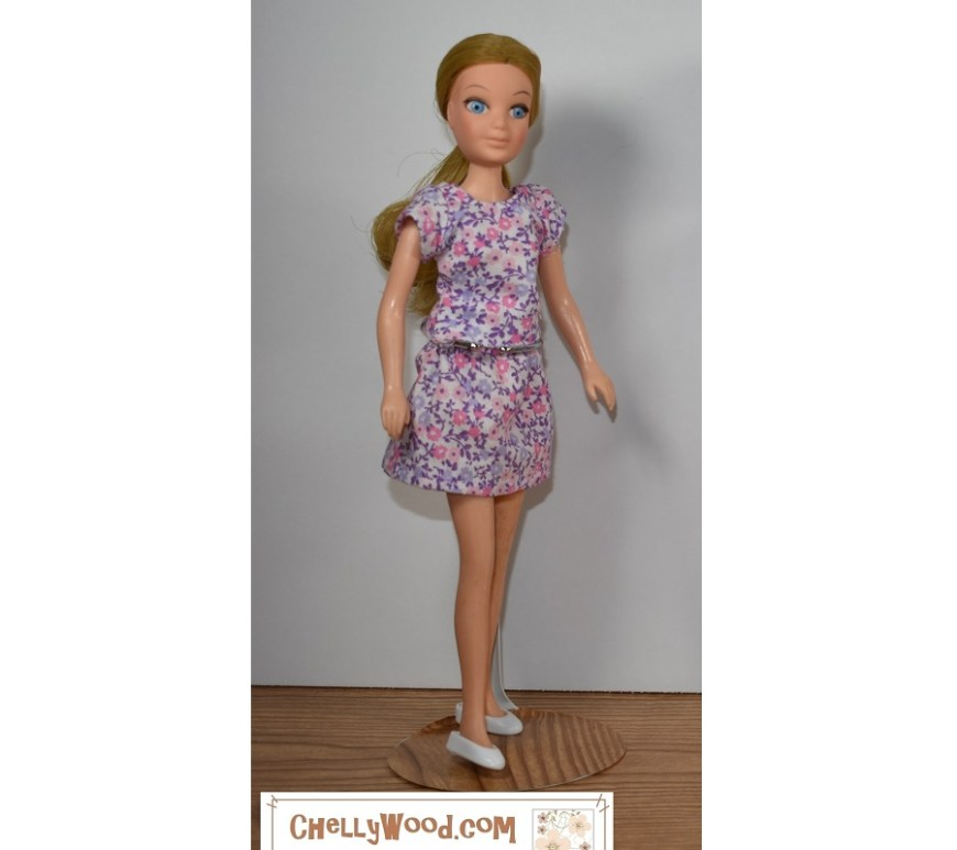 "The image shows a ""Love"" doll from the Hasbro World of Love vintage doll collection, and she's modeling a purple and pink print matching top and miniskirt, which were handmade using free printable PDF sewing patterns and tutorial videos found at ChellyWood.com"