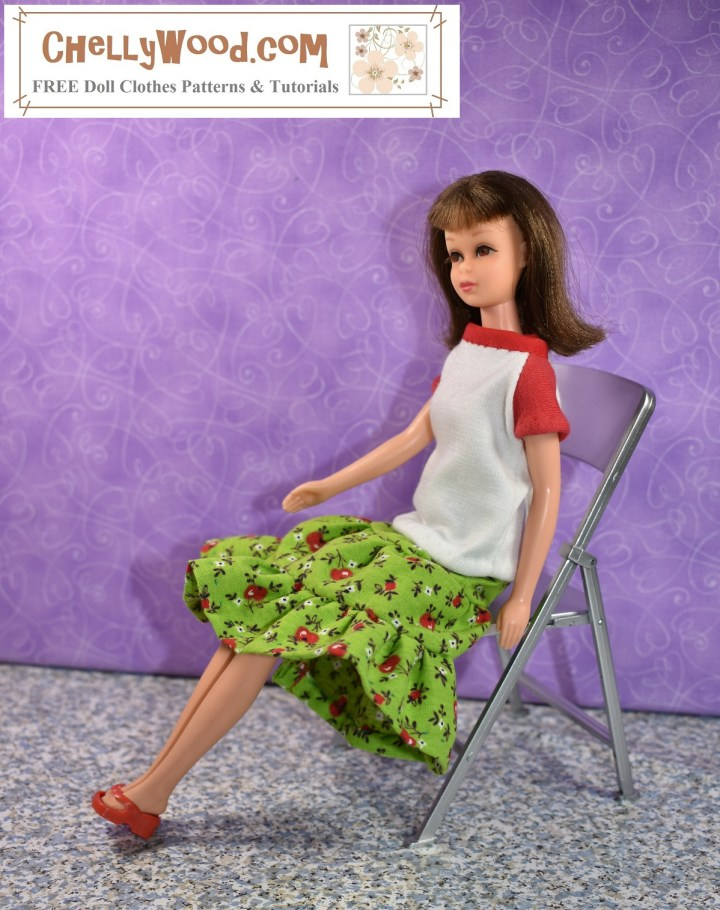 Here we see a vintage Francie doll seated in a folding chair. She models handmade doll clothes that were made using the free printable PDF sewing patterns found at ChellyWood.com including a raglan-sleeved T-shirt and a three-tier (3-tier) skirt. The raglan-sleeved shirt is white with a red collar and red sleeves (made of jersey fabric). The 3-tier skirt is green with red apples and darker green leaves (made of cotton fabric). The doll also wears a pair of red flip-flop sandals. The watermark reminds us to visit ChellyWood.com for free printable sewing patterns for making this and many other outfits.