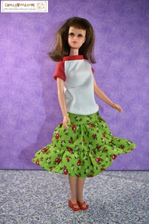 The image shows a vintage Francie doll wearing a handmade raglan-style T-shirt and a 3-tier skirt with ruffled layers. If you'd like to make this outfit for your Francie doll, please click on the link found in the caption.