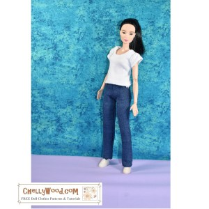 The image shows a Mattel MTM Barbie wearing handmade stretch denim jeans and a T-shirt. The page associated with this image offers a free printable PDF sewing pattern for three styles of pants or jeans to fit fashion dolls like Barbie and other 11 inch dolls.
