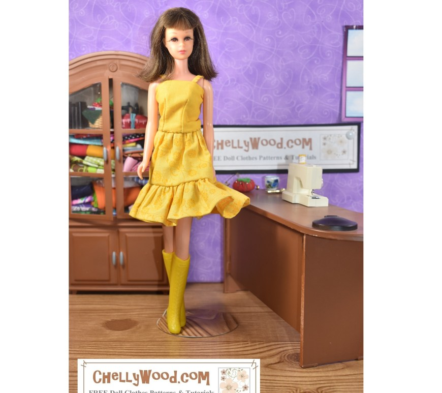 The image shows a vintage Francie doll wearing a handmade tank top and skirt. The skirt has an elastic waist and a ruffle. The doll also wears matching butter-yellow go-go boots from the early 1970's. The doll models this lovely butter yellow doll clothes outfit in a sewing room. Behind her is a cabinet filled with fabric. At her right hand is a tiny sewing machine on a desk with a pair of scissors and a tiny tomato-shaped pin cushion. The overlay tells where you can download the free printable sewing patterns and watch the tutorial videos for making these doll clothes: ChellyWood.com