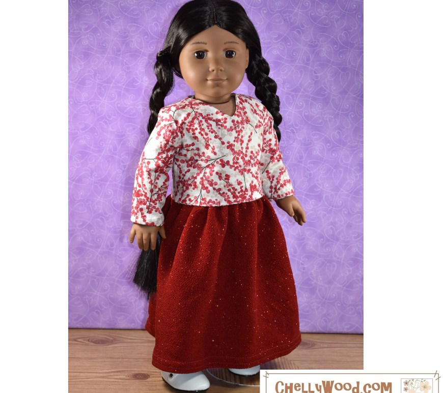 "The image shows an 18-inch ""Kaya"" American Girl doll, wearing handmade doll clothes that were sewn using the free printable PDF sewing patterns found at ChellyWood.com. These free 18 inch doll clothes sewing patterns included a pattern for a long holiday skirt made of glittery red fabric and a long-sleeved V-neck blouse made of winter berry red and white cotton fabric. The doll's long braided hair goes all the way down her back, looking especially elegant with her long skirt. She wears white Mary Jane ""patent leather"" style shoes. The overlaying watermark tells you to go to ChellyWood.com for your free printable PDF sewing pattern for making doll clothes for dolls of many shapes and all different sizes."