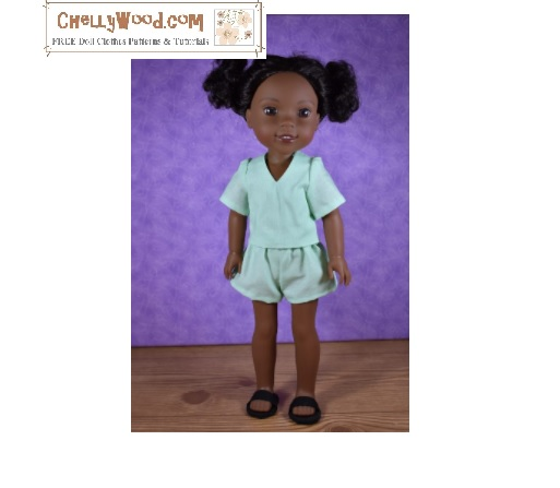The image shows a 14 inch Wellie Wishers doll wearing handmade shorts with a back pocket and a V-neck shit with short-ish sleeves. If you'd like to learn how to sew these doll clothes, and/or if you'd like to download the free printable PDF sewing pattern for making these Wellie Wisher sized doll clothes for 14 inch dolls, visit ChellyWood.com where you can find the free pattern under the 13 to 16 inch doll clothes patterns gallery.
