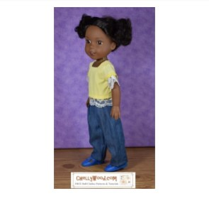 The image shows a 14 inch Wellie Wisher doll from American Girl doll company wearing a pair of handmade elastic-waist jeans and a lace-trimmed shirt with a square neckline. The watermark tells where you can download the free PDF sewing patterns for making this outfit for your Wellie Wishers: ChellyWood.com