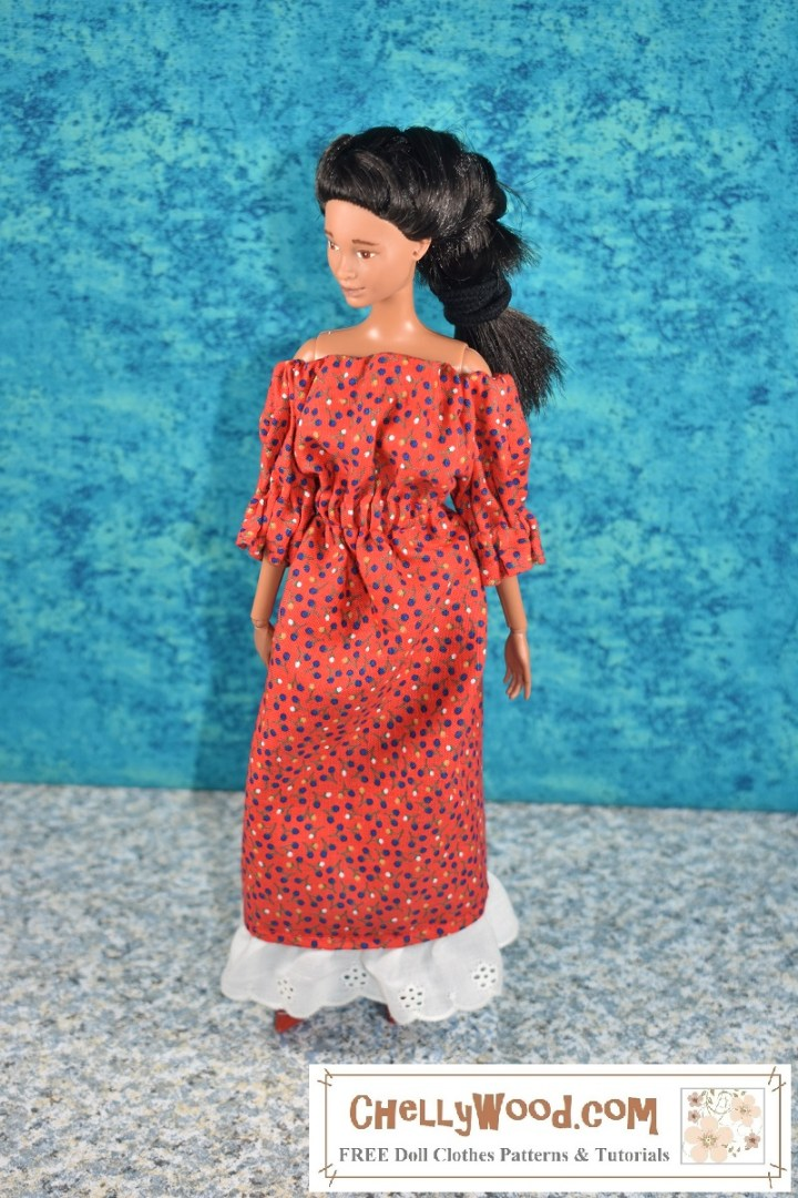The image shows a handmade doll dress with an elastic waist, elastic at the sleeves, and elastic at the neckline which is pulled down to expose the dolls' shoulders. The doll wearing the dress is a Mattel Barbie with African American skin tone and black hair. Her face paint has been removed and her face has been repainted to look like the doll is all-natural without any make-up on. The dress is made of red floral fabric. The bottom of the dress is edged with white eyelet ruffles. The overlay tells where to learn more about the pattern used to make this dress: ChellyWood.com