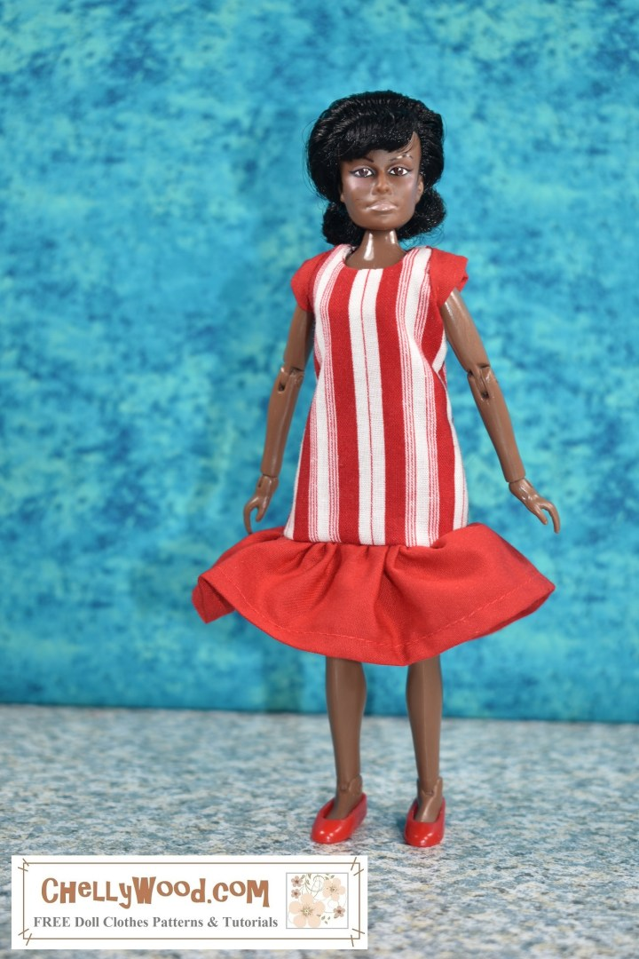The image shows a Mego Lieutenant Uhura action figure modeling a red and white striped dress with a ruffle and cap sleeves. The doll is in the image and likeness of Nichelle Nichols. If you'd like to make the dress shown in this image, please click on the link provided in the caption. It will take you to a page where you can easily down the free printable PDF sewing pattern and view the sewing tutorial with steps showing how to make this dress to fit your Mego action figures or similar-sized dolls.