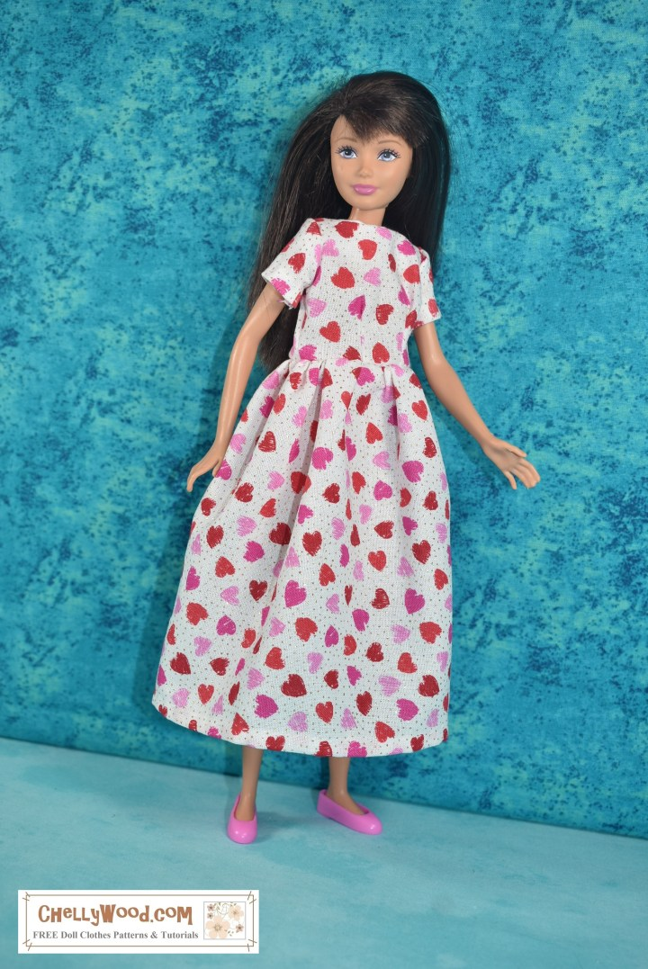 The image shows a Mattel Skipper doll wearing a handmade dress of white fabric decorated with tiny pink and red hearts. The doll also wears pink flat shoes. She stands before a pretty turquoise blue background. The overlaid watermark tells you to visit ChellyWood.com for all your free printable sewing patterns for making doll clothes to fit dolls of many shapes and all different sizes.