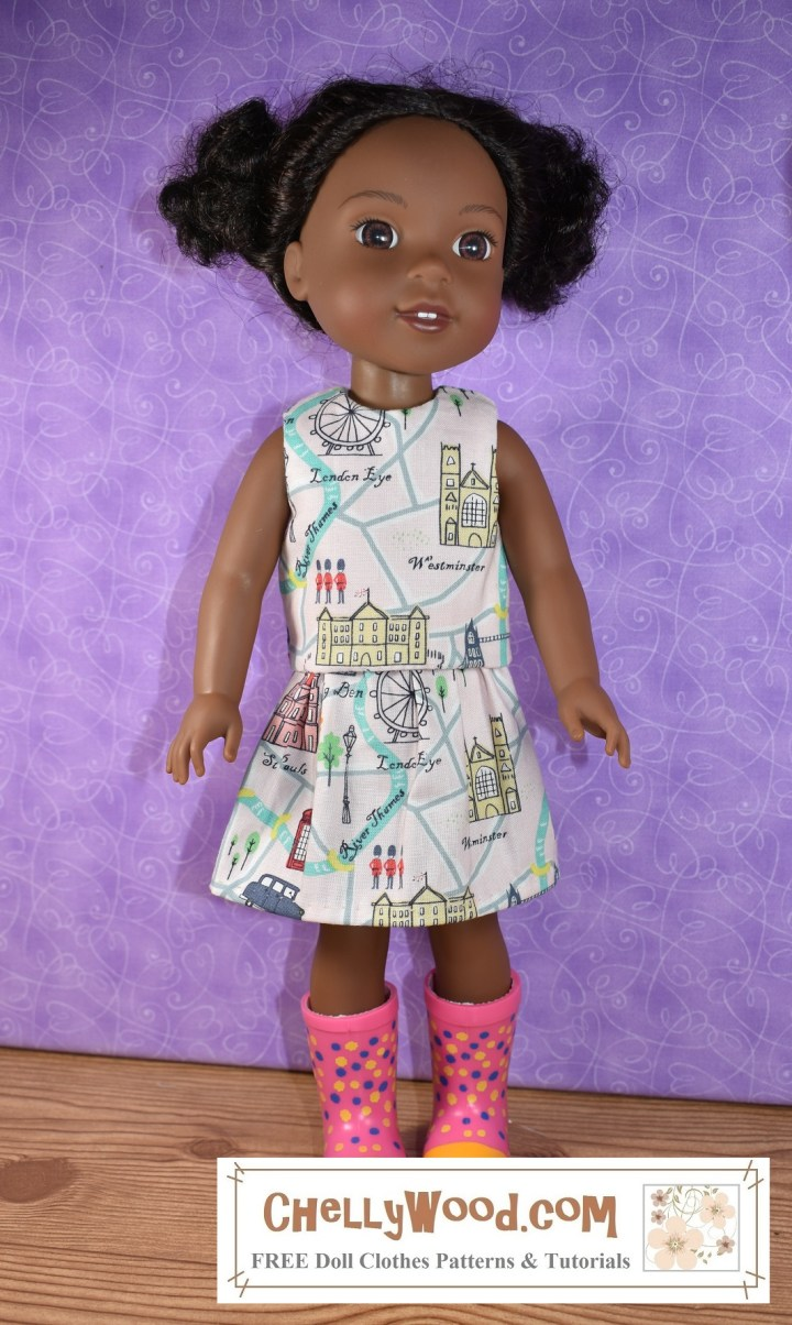 """To get to the free patterns and tutorials, please click on the link provided in the caption. The image shows a 14 and a half inch Wellie Wishers doll from American Girl doll company modeling a handmade doll skirt and matching shirt. The fabric used is a """"London-themed"""" printed fabric made of 100% cotton. This fabric was purchased at Hobby Lobby. If you'd like to make your own version of this outfit (a shirt and matching skirt), go to ChellyWood.com for the free printable PDF sewing patterns and the free tutorial videos showing how to make each item of doll clothes modeled here."""