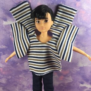 """Today's blog post asks, """"How did you learn about ChellyWood.com?"""" And the blog post is accompanied by this image, which Chelly posted on Instagram and Facebook recently. She's doing a poll on her website, to see where most of her followers learn about her website, and this image of a Creatable World doll wearing jeans and a half-finished shirt (Chelly's work-in-progress sewing project) was posted on Chelly's Instagram page recently."""