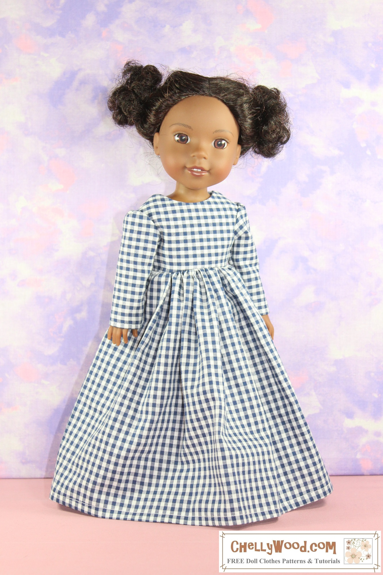 Here we see a Wellie Wishers (Kendall) doll modeling a pretty blue gingham dress with a simple scoop neck, long sleeves that are slightly puffy at the top of the sleeve, and a long gathered skirt. Would you like to make this lovely Victorian-era dress for your 14 to 15 inch doll? Click on the link in the caption to navigate over to the page that has all the patterns and tutorial videos for sewing this beautiful dress.