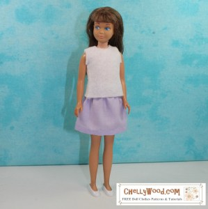 Vintage skipper wears a light purple (lavender colored) skirt and a white felt sleeveless shirt. The watermark reminds us to visit Chelly Wood dot com for free doll clothes patterns and tutorials.