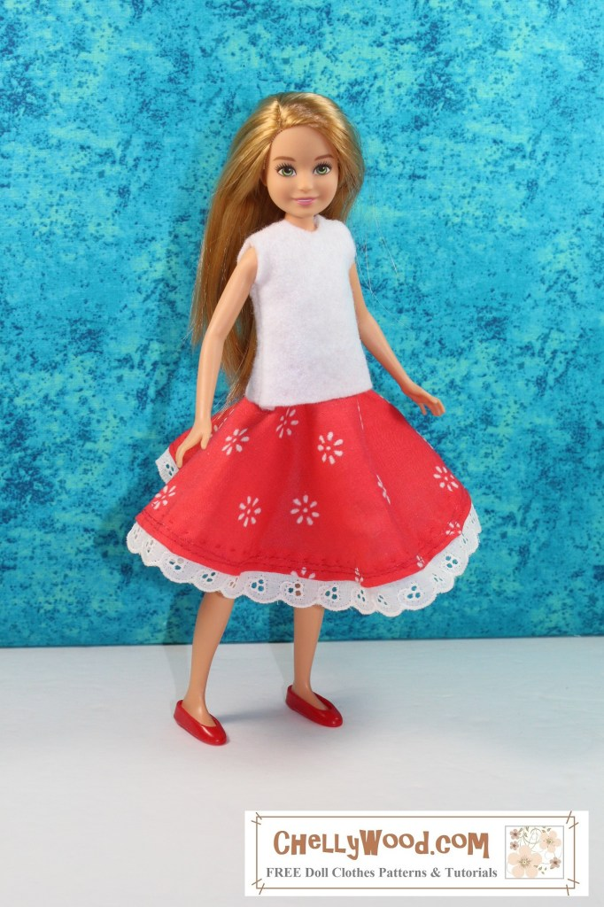 The image shows a Mattel Stacie doll modeling a red circular skirt decorated with small white flowers. The skirt is trimmed in delicate eyelet lace. She wears a white felt sleeveless shirt over the top of this skirt.