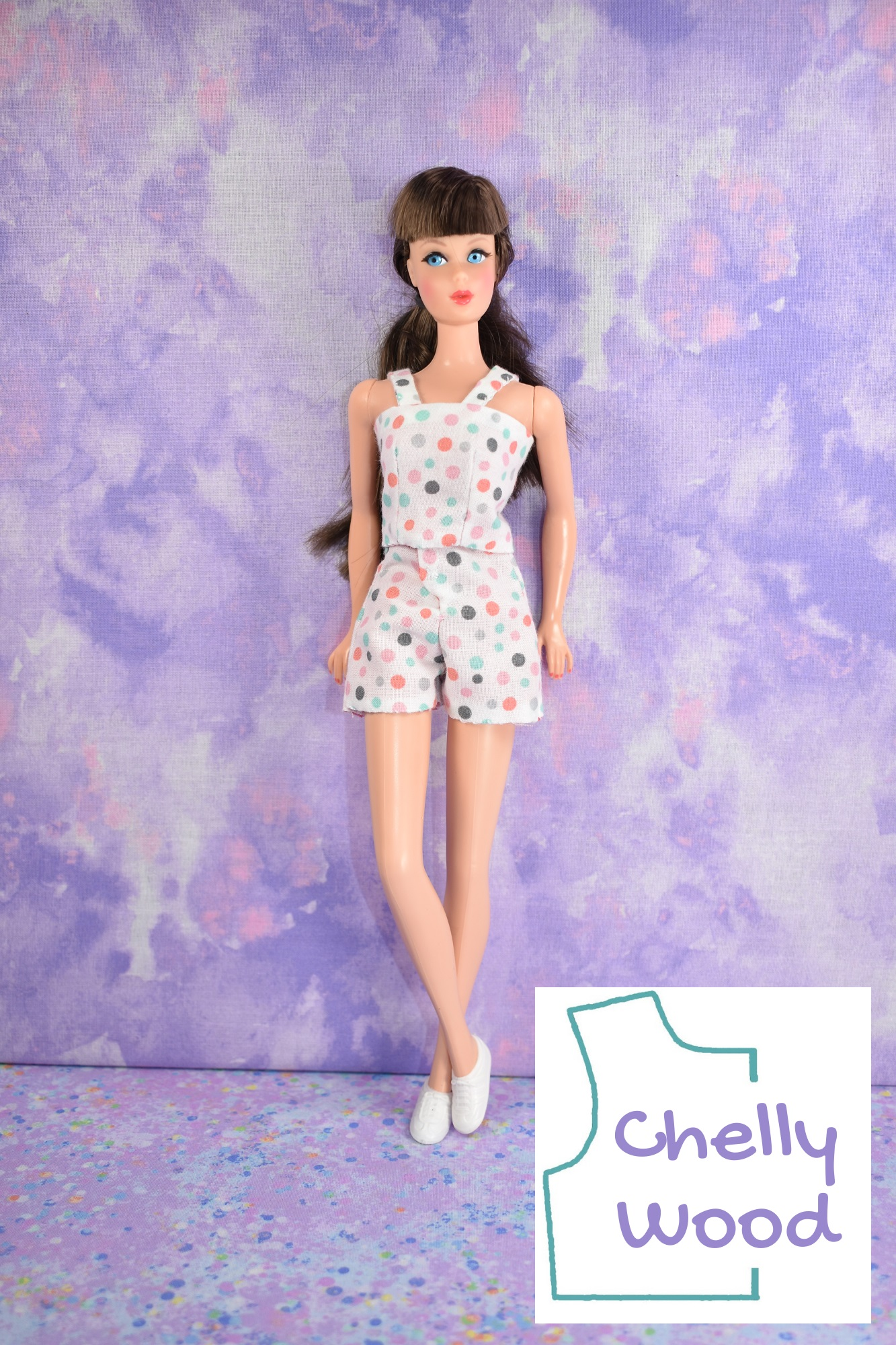 The image shows a vintage Barbie modeling a handmade reversible tank top and a pair of high-waist shorts with a front fly. Would you like to make this outfit? If so, please click on the link in the caption.