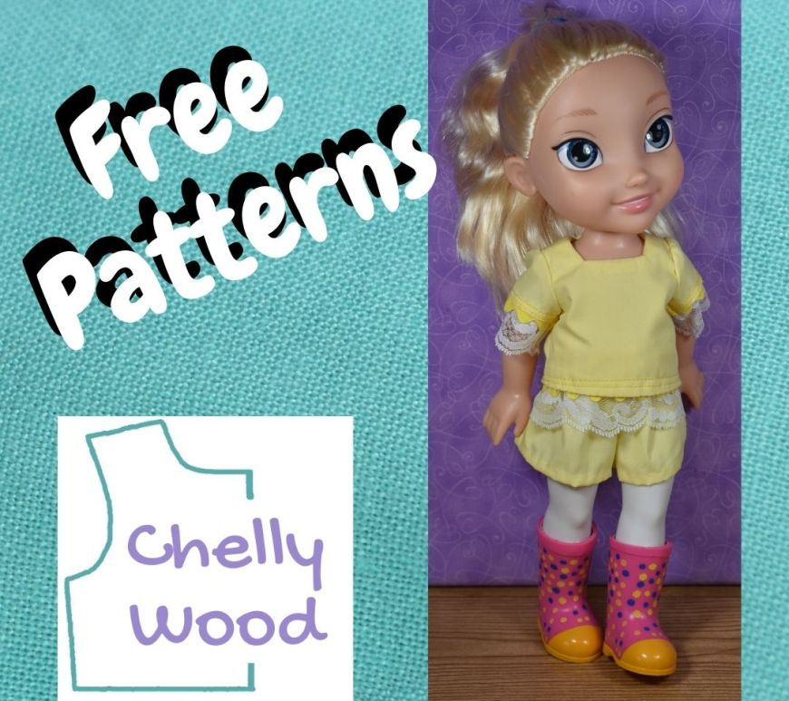"""Would you like to make a pair of shorts and a square-neck blouse for your Disney Princess Toddler dolls? This blog post offers the free printable PDF sewing patterns for making the doll clothes shown in this photo (shorts and a short sleeved shirt with lace trim). The photo of the Elsa doll wearing these doll clothes is overlaid onto a turquoise blue linen background with the words """"free patterns"""" over the top of the Chelly Wood dot com logo."""