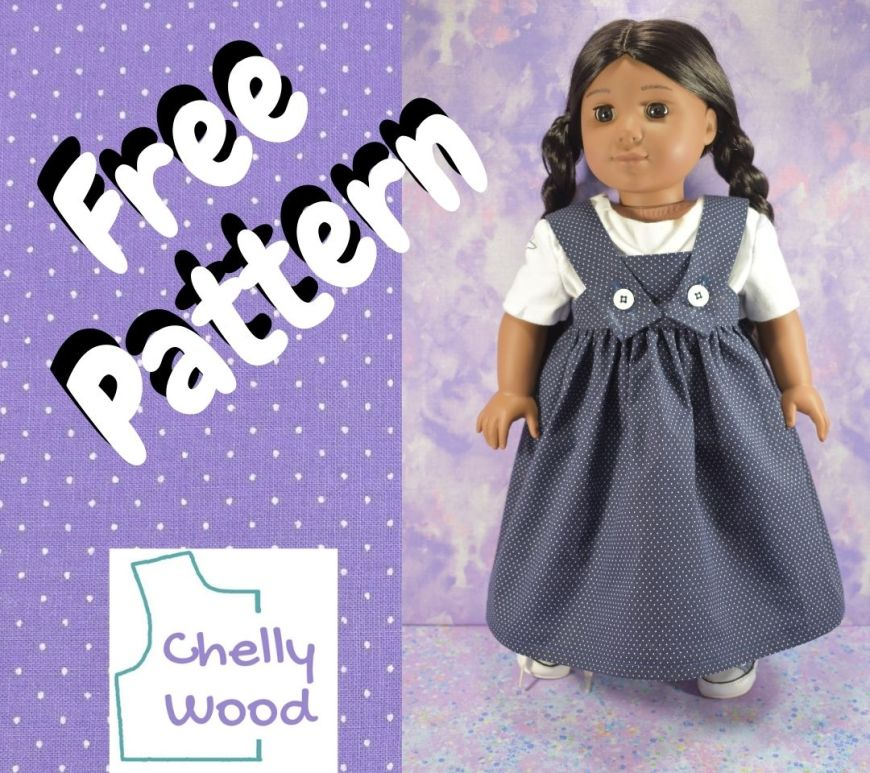 """This is a square of dotted Swiss fabric in a purple color with tiny white dots on it. Overlaid on the fabric frame are the words """"free pattern"""" and the Chelly Wood dot com logo. We also see a photograph of a Kaya doll wearing a white tee shirt with a pinafore style sundress that has straps attached to the front of the dress using white buttons. Her dress is made of navy blue dotted swiss cotton fabric, and her braided hair is behind her. Kaya is an American Girl 18 inch doll, and the free printable PDF sewing patterns for making this pinafore style cotton sun dress will fit most 18 inch dolls like the American Girl brand of dolls."""