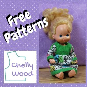 """This image shows a purple square swatch of dotted Swiss fabric, forming a frame around the words """"free patterns,"""" the logo for Chelly Wood dot com, and a photo of a vintage Heart Family baby doll wearing a handmade Easter egg dress."""