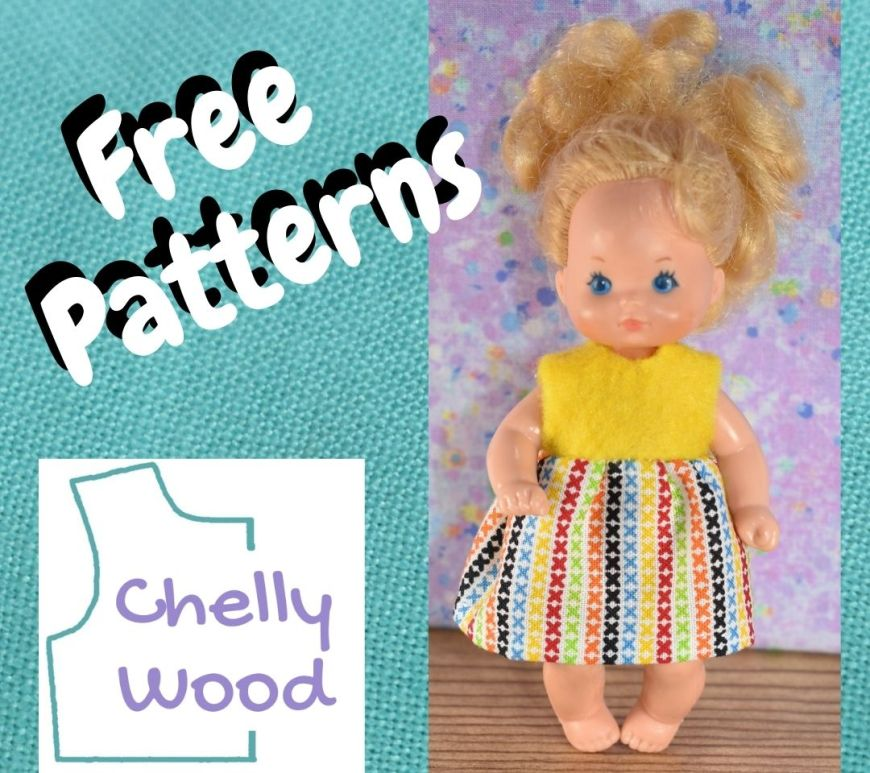 """A turquoise blue linen background is seen behind the words """"free patterns"""" and the logo for ChellyWood.com along with a photo of a female Mattel Heart Family baby doll with curly blond hair. The doll wears a handmade dress with a sleeveless yellow felt bodice and a multicolored gathered cotton skirt."""