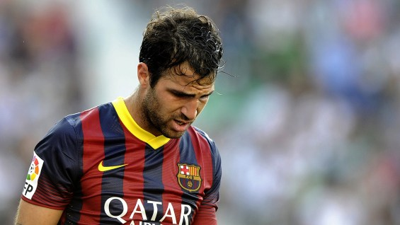 Barcelona's midfielder Cesc Fabregas reacts during the Spanish league football match Elche CF vs FC Barcelona at the Martinez Valero stadium in Elche on May 11, 2014. AFP PHOTO/ JOSE JORDAN (Photo credit should read JOSE JORDAN/AFP/Getty Images)