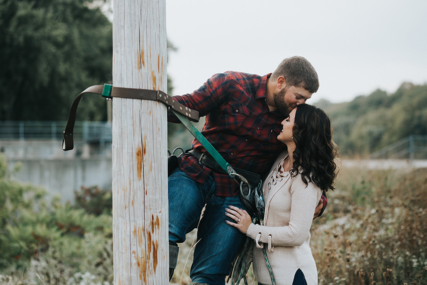 Telephone_Pole_Lineman_Kiss_Photo_Iowa_Engagement_Photographer_Adventure_Session_Backbone_State_Park