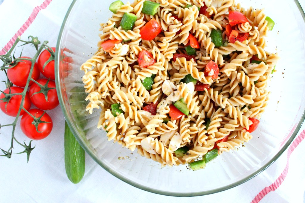 Picnic season is here! Make this easy pasta salad for your next picnic or outdoor event. Tip- make this healthy side in advance. It'll save you time the day of and it tastes better the longer it sits.