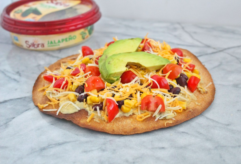 My vegetarian Mexican pizzais the perfect throw together appetizer, lunch, or dinner. Made with just 7 simple ingredients, this zesty twist on the Italian classic will be a new family favorite.