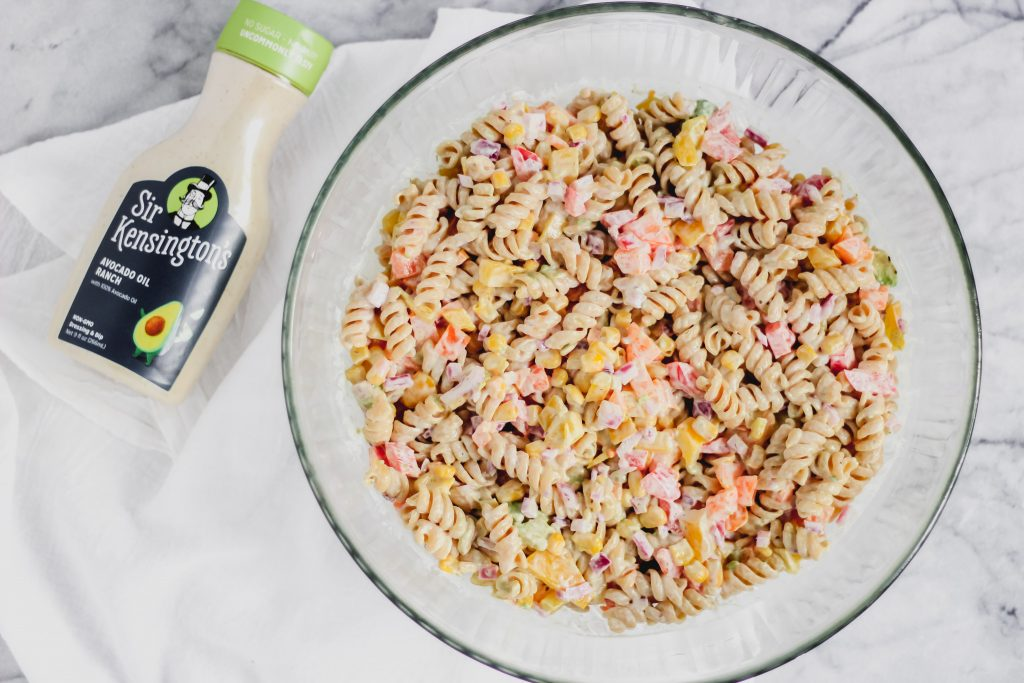 Searching for the perfect side dish for your 4th of July party? Look no further. My lightened up Avocado Ranch Pasta Salad is ready in no time and is packed with wholesome ingredients. Best of all, it tastes amazing and is made with RANCH! Really, what more could you want?