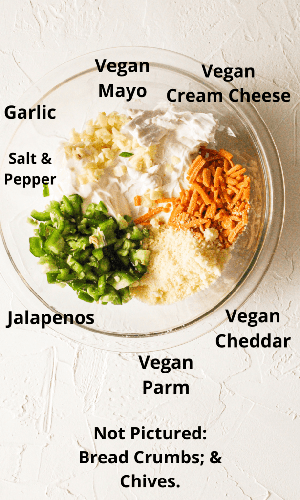 Vegan Jalapeno Dip ingredients in a clear mixing bowl. All ingredients are labaked