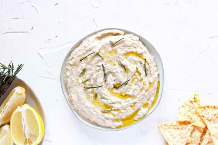 Rosemary Lemon Hummus in a bowl with rosemary on top