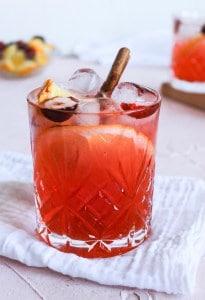 Spiced Orange Cranberry Spritz in a glass with garnish