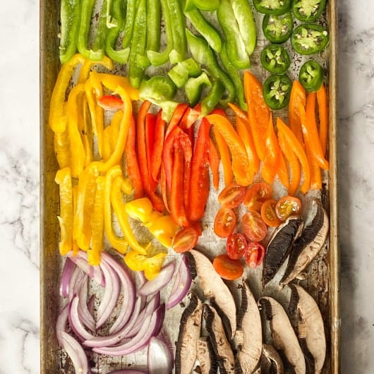Veggies for Black Bean Tacos on Sheet Pan (Pre Cooked) which includes peppers, jalapenos, mushrooms, onions