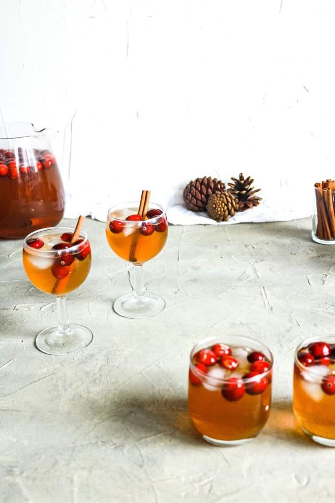 Four glasses of Cranberry Vanilla Chai Sangria