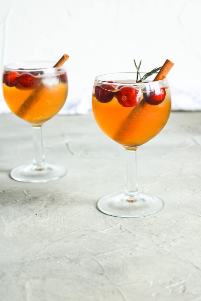 Two glasses of Cranberry Vanilla Chai Sangria with cranberries