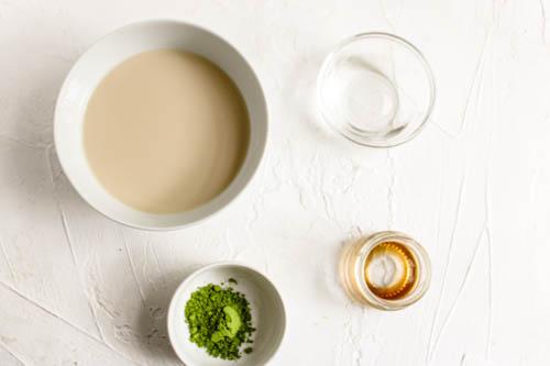 Ingredients to make oat milk matcha latte