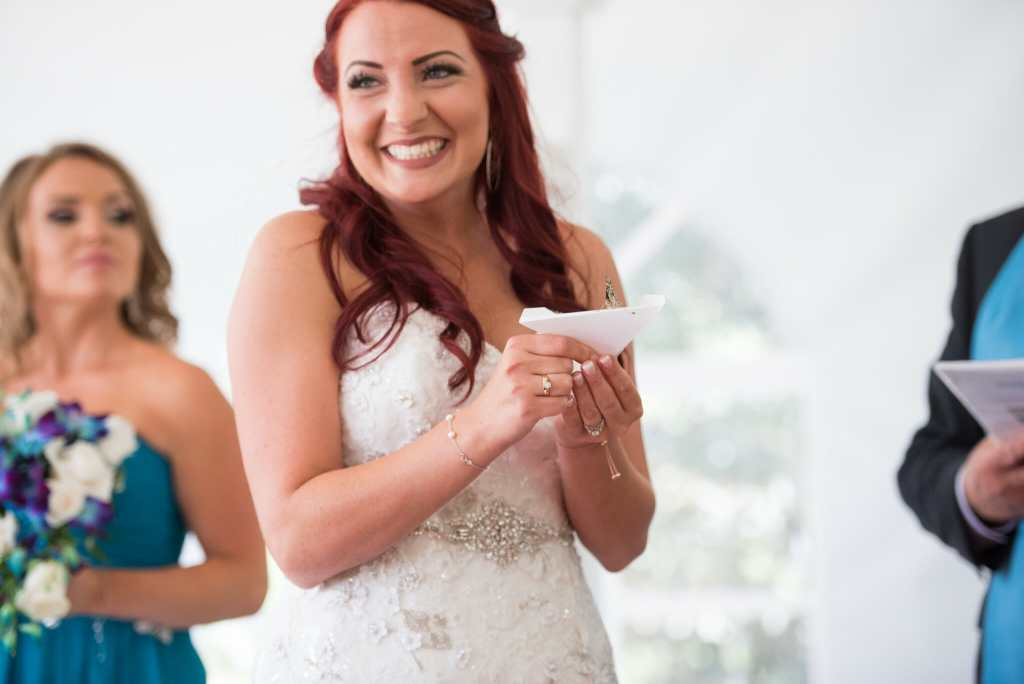 bride letting go of butterfly during ceremony