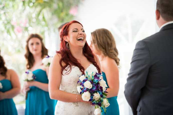 bride laughs during wedding ceremony