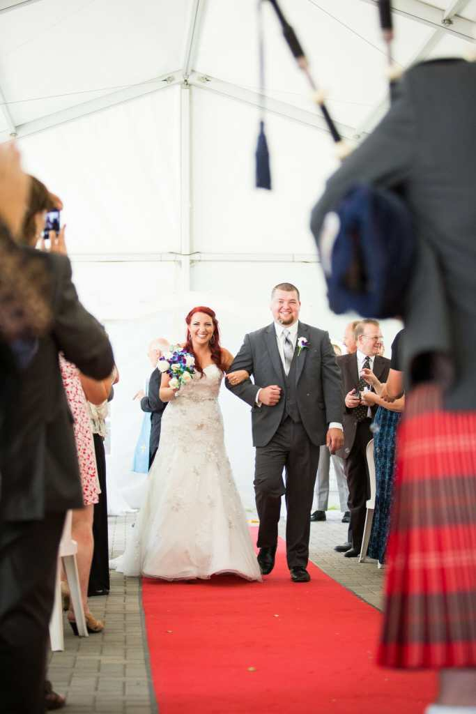 newlyweds walk down the aisle at garden wedding