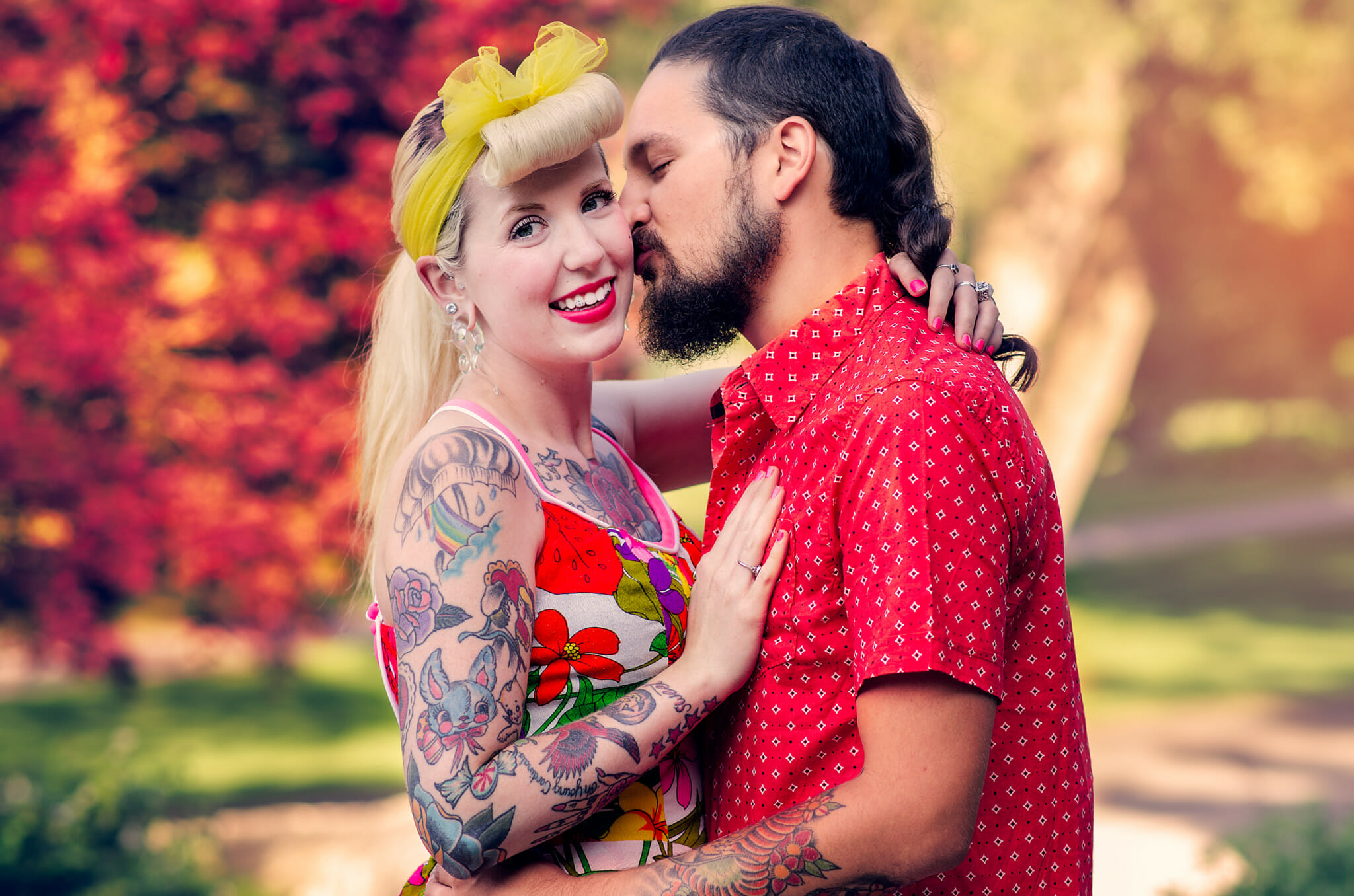 boyfriend kisses girlfriends cheek in park