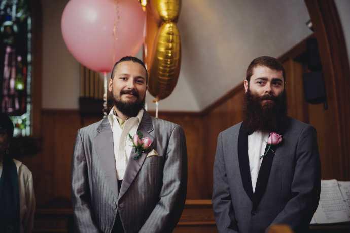 groom waits for bride to walk down aisle