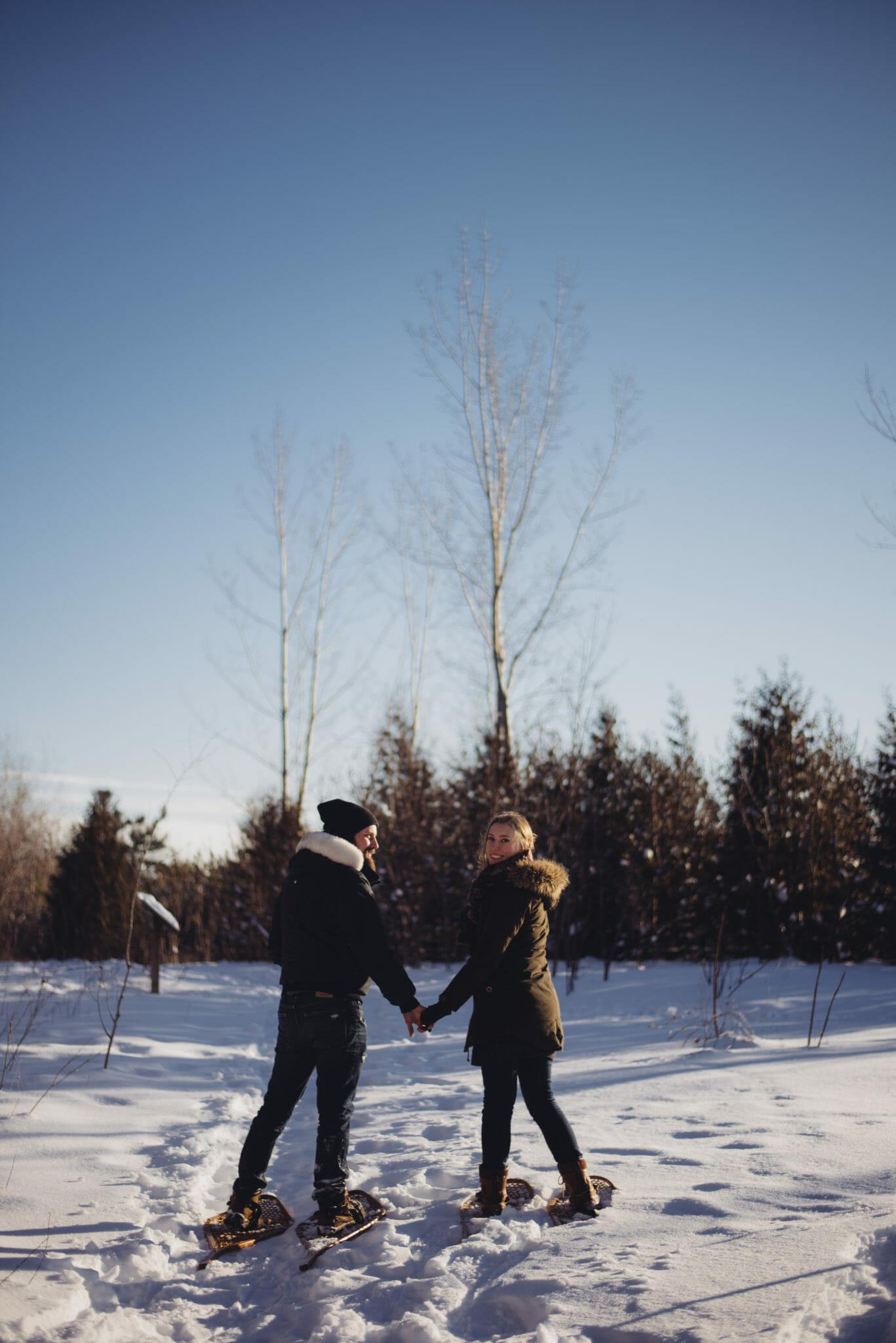 trail snowshoeing engaged couple greenwood