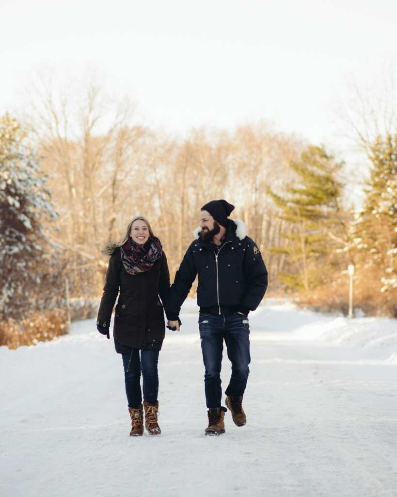 couple walking down path at greenwood conservation area
