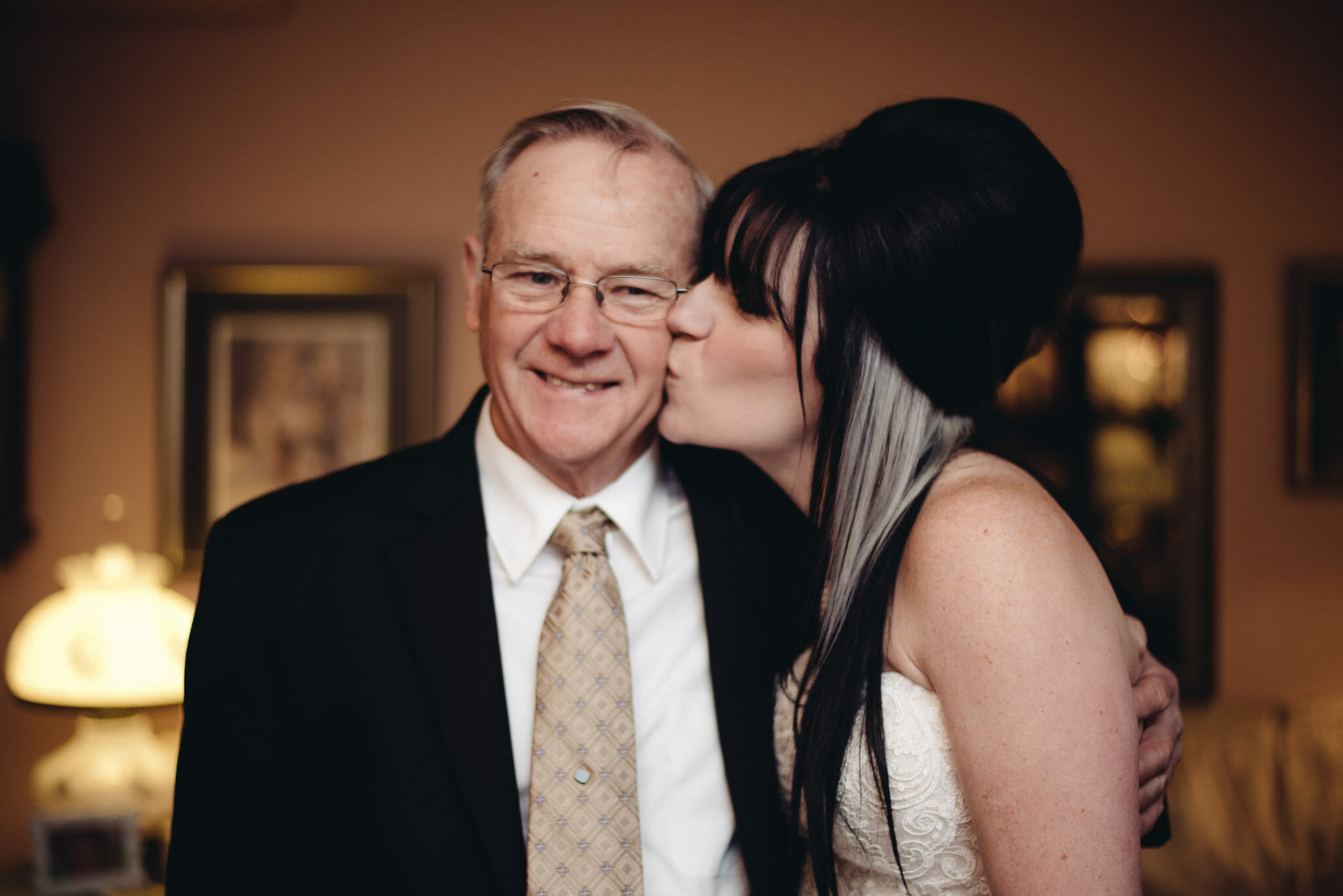 bride kisses father before leaving for wedding at st joesphs bowmanville