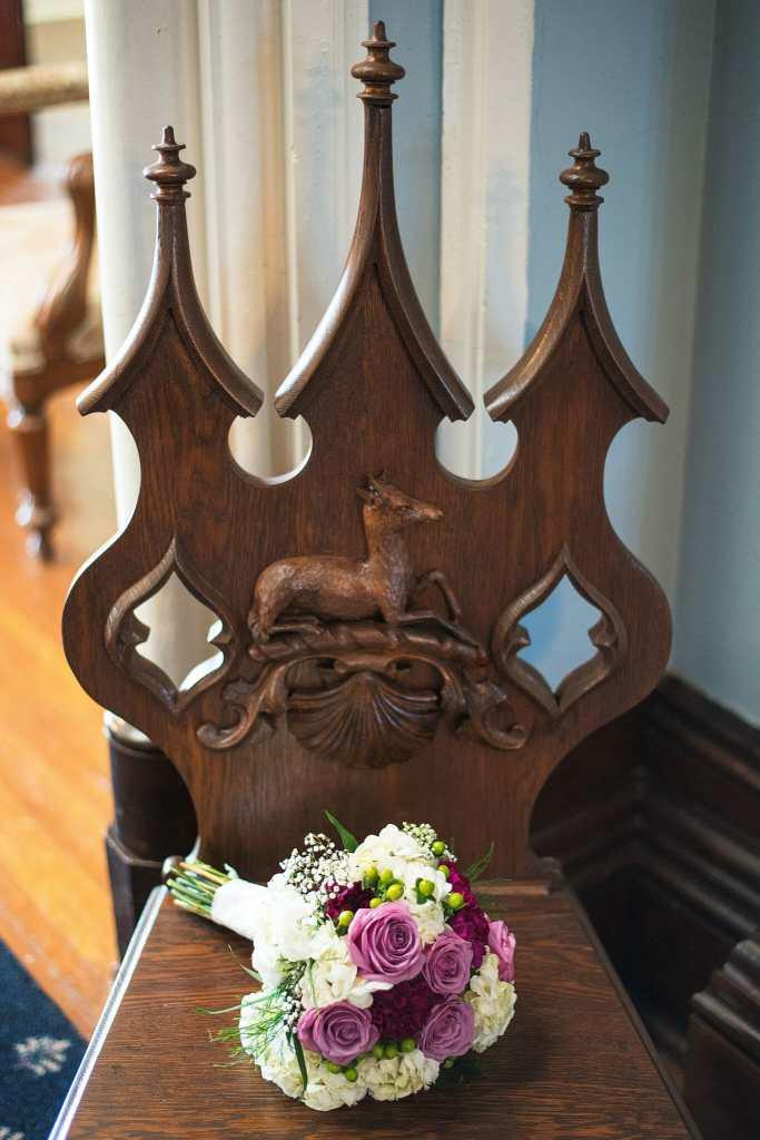 bridal bouquet on antique chair at trafalgar castle wedding