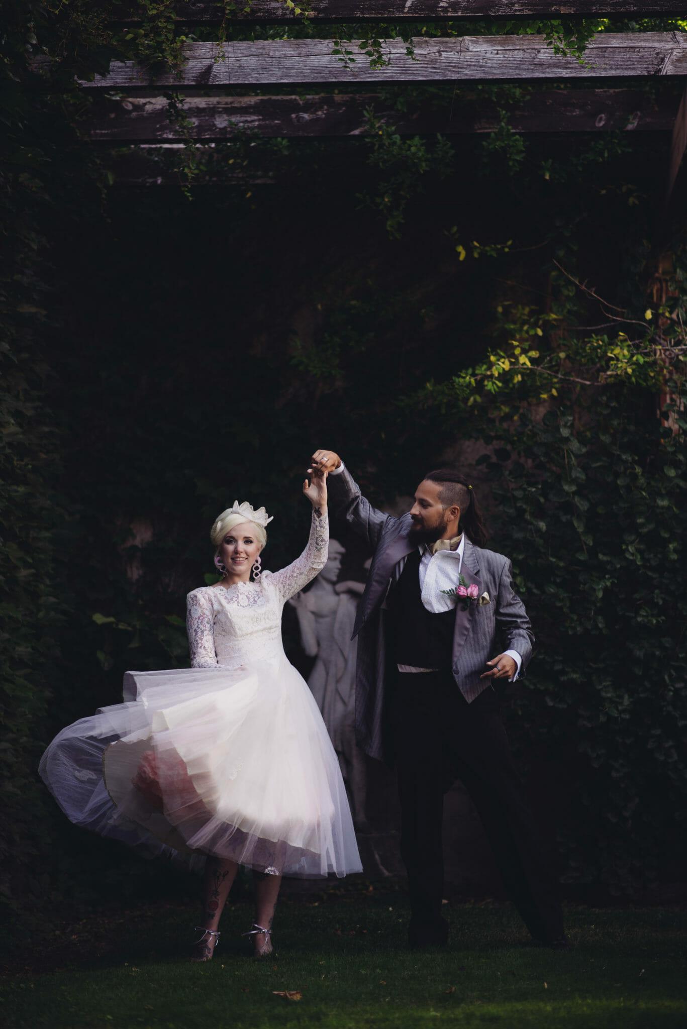 groom swirls bride in front of parkwood house oshawa