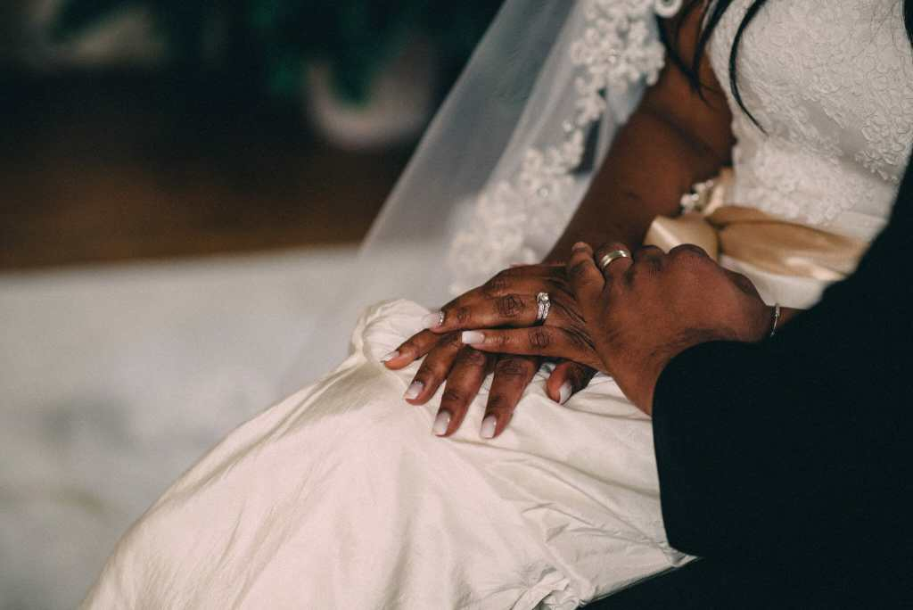 bride and groom hands showing rings